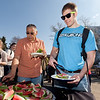 "Luke George serves himself a plateful of watermelon during the Kick-Off BBQ of the University of Alaska Fairbank's 2012 Spring Fest.  <div class=""ss-paypal-button"">Filename: LIF-12-3374-8.jpg</div><div class=""ss-paypal-button-end"" style=""""></div>"