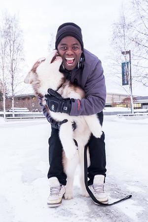 Bertrand Dushime brings his malemute to campus during winter break.  Filename: LIF-15-4424-8.jpg