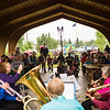 "People take shelter at the pavilion while a handful of individuals brave the weather with their umbrellas as they listen to music by the Opera Fairbanks Orchestra Brass on a rainy evening at the Georgeson Botanical Garden as part of Summer Sessions' Music in the Garden series.  <div class=""ss-paypal-button"">Filename: LIF-13-3884-14.jpg</div><div class=""ss-paypal-button-end"" style=""""></div>"