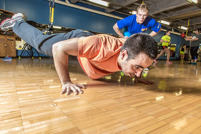 Gavin Meggert, a personal trainer at the SRC, helps supervise Aaron Orr on his fitness routine during a workout session.  Filename: LIF-14-4111-35.jpg