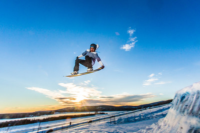 Students enjoy some of the features of UAF's terrain park on a spring afternoon.  Filename: LIF-13-3746-46.jpg