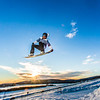 """Students enjoy some of the features of UAF's terrain park on a spring afternoon.  <div class=""""ss-paypal-button"""">Filename: LIF-13-3746-46.jpg</div><div class=""""ss-paypal-button-end"""" style=""""""""></div>"""