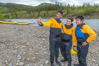 International students Jabez Chinnam, Neha Agrawal and Mohit Paryani pose for a group selfie before a UAF Outdoor Adventures raft trip down the Nenana River in June, 2014.  Filename: OUT-14-4211-008.jpg