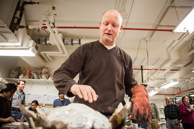 Ceramics professor Jim Brashear takes out another clay-covered turkey, which was baked in a kiln during the annual Thanksgiving gathering at the ceramics department.  Filename: LIF-12-3660-61.jpg
