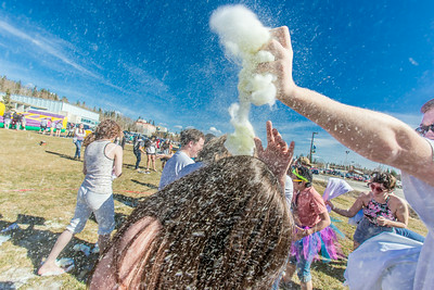 Pillows filled with fluff and colored dye were used during a fun pillow fight as one of the attractions at UAF's SpringFest Field Day April 28.  Filename: LIF-14-4168-260.jpg