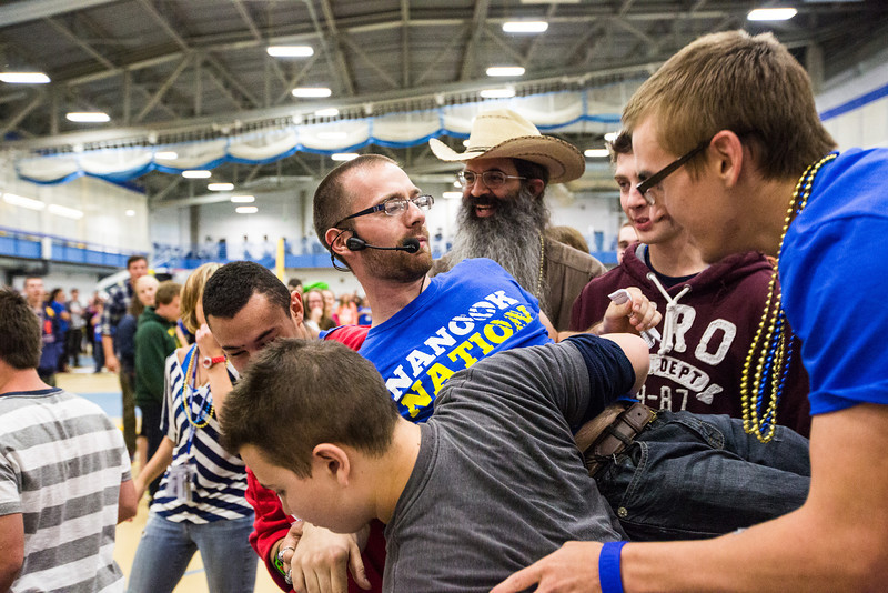 """Incoming students carry New Student Orientation Director Damien Snook as part of a scavenger hunt during the New Student Orientation at the Student Rec. Center.  <div class=""""ss-paypal-button"""">Filename: LIF-13-3924-233.jpg</div><div class=""""ss-paypal-button-end"""" style=""""""""></div>"""