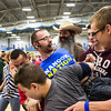 "Incoming students carry New Student Orientation Director Damien Snook as part of a scavenger hunt during the New Student Orientation at the Student Rec. Center.  <div class=""ss-paypal-button"">Filename: LIF-13-3924-233.jpg</div><div class=""ss-paypal-button-end"" style=""""></div>"
