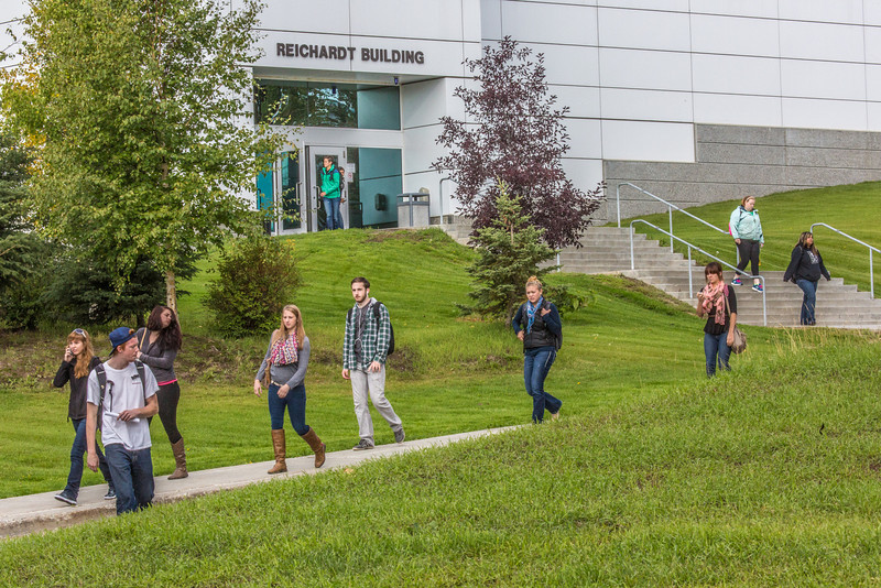 """Students leave the Reichardt Building after class on the first day of the 2013 fall semester.  <div class=""""ss-paypal-button"""">Filename: LIF-13-3928-48.jpg</div><div class=""""ss-paypal-button-end"""" style=""""""""></div>"""