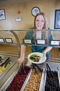 Junior Anastasia Brease loads up on vegetables during lunch in the Lola Tilly Commons.  Filename: LIF-11-3220-090.jpg