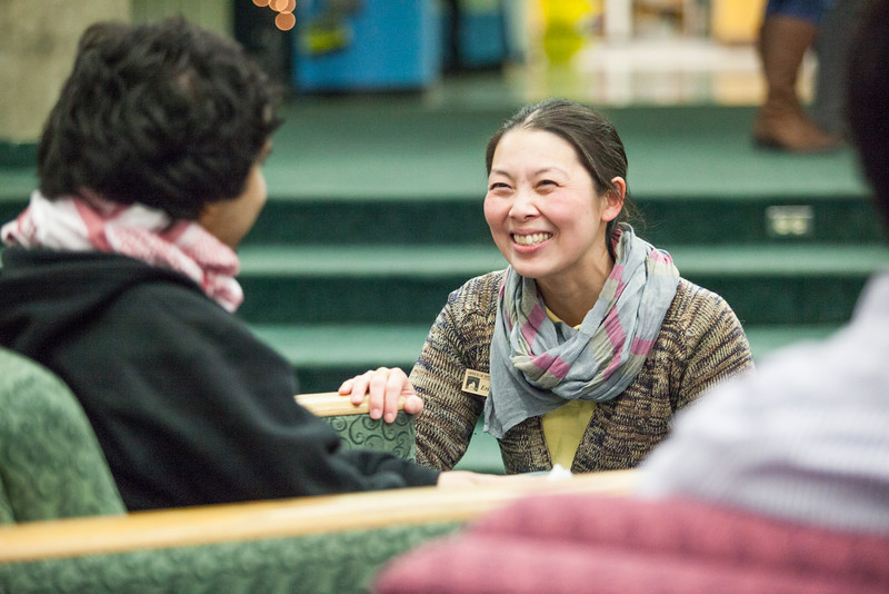 """Student and Exchange and Study Abroad Advisor Erica Keiko Iseri, speaks with Fahad Alshamman of Saudi Arabia before the Flag Dedication Ceremony, Friday, Nov. 16, 2012 at the Wood Center.  <div class=""""ss-paypal-button"""">Filename: LIF-12-3655-1.jpg</div><div class=""""ss-paypal-button-end"""" style=""""""""></div>"""