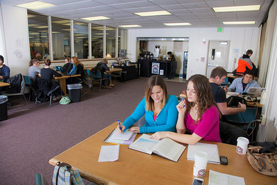 UAF students Megan Gilmore and Ashley Bartolowits sit with their cofee and study materials in the 24-hour study area of the Rasmuson Library.  Filename: LIF-11-3212-119.jpg