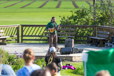 Local musician Ukulele Russ entertained a nice crowd during UAF Summer Session's free Music in the Garden concert series June 12.  Filename: LIF-14-4209-11.jpg