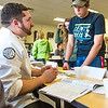 """Staff members turn out to answer community members' questions during the UAF Community and Technical College's (CTC) fall semester round up.  <div class=""""ss-paypal-button"""">Filename: LIF-15-4619-17.jpg</div><div class=""""ss-paypal-button-end""""></div>"""