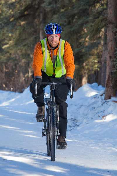 """Frank Olive, assisant coordinator of programming for UAF Outdoor Adventures, rides his bike to work on campus on a spring afternoon.  <div class=""""ss-paypal-button"""">Filename: LIF-12-3340-67.jpg</div><div class=""""ss-paypal-button-end"""" style=""""""""></div>"""