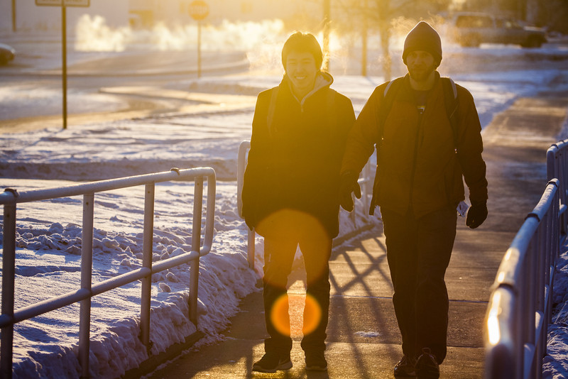 """Students walk from the Lola Tilly Commons on route to campus on a cold December day.  <div class=""""ss-paypal-button"""">Filename: LIF-12-3664-5.jpg</div><div class=""""ss-paypal-button-end"""" style=""""""""></div>"""