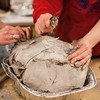 "Danielle Anderson and Teresa Shannon break the clay shell before carving the turkey at the annual Thanksgiving gathering at the ceramics department.  <div class=""ss-paypal-button"">Filename: LIF-12-3660-18.jpg</div><div class=""ss-paypal-button-end"" style=""""></div>"