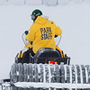 "Student employees and staff members work to groom the big jump on UAF's Terrain Park on a snowy spring afternoon.  <div class=""ss-paypal-button"">Filename: LIF-13-3721-66.jpg</div><div class=""ss-paypal-button-end"" style=""""></div>"