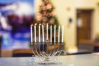 A menorah on display in Signers' Hall burns on the third day of Hanukkah, 2014.  Filename: LIF-14-4417-23.jpg