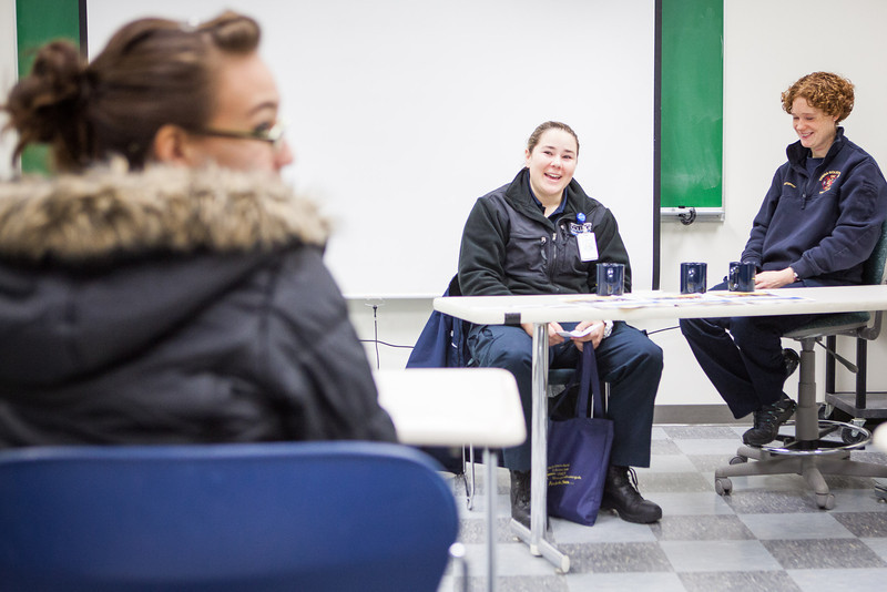 """Elizabeth Dougherty, center, and Ashley Wages, left, discuss programs offered by UAF Community and Technical College at the 2012 Alaska Interior Medical Education Summit Saturday, Oct. 27, 2012 at the Reichardt Building.  <div class=""""ss-paypal-button"""">Filename: LIF-12-3617-10.jpg</div><div class=""""ss-paypal-button-end"""" style=""""""""></div>"""