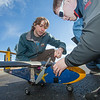"Engineering students Sam Brewer, left, and Corey Upton adjust their model plane before sending it aloft for a test flight over a parking lot on the Fairbanks campus.  <div class=""ss-paypal-button"">Filename: LIF-12-3366-004.jpg</div><div class=""ss-paypal-button-end"" style=""""></div>"