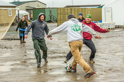It's staff members versus student researchers from Lab 1 during a wet and muddy soccer match on a summer night at UAF's Institute of Arctic Biology's Toolik Field Station on Alaska's North Slope.  Filename: LIF-14-4216-135.jpg