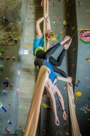 Undergraduates Miriam Brooks, bottom, and Teal Rogers practice their silk climbing skills in the SRC.  Filename: LIF-13-3819-47.jpg