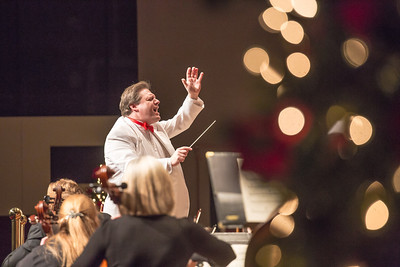Conductor Eduard Zilberkant leads the Fairbanks Symphony Orchestra in their annual holiday performance in the Davis Concert Hall.  Filename: LIF-12-3669-19.jpg
