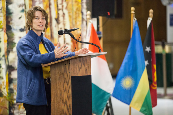 """UAF International Programs & Initiatives Director Donna Anger  welcomes new students from Ethiopia, Côte d'Ivoire, Papua New Guinea, Rwanda and Saudi Arabia at a flag dedication ceremony at the Friday, Nov. 16, 2012, at the Wood Center.  <div class=""""ss-paypal-button"""">Filename: LIF-12-3655-4.jpg</div><div class=""""ss-paypal-button-end"""" style=""""""""></div>"""