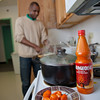 "Peter Ikewun, a petroleum engineeering graduate student from Nigeria, prepares a traditional African soup in his communal Wickersham Hall kitchen.  <div class=""ss-paypal-button"">Filename: LIF-12-3268-069.jpg</div><div class=""ss-paypal-button-end"" style=""""></div>"