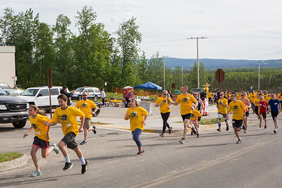 Participants in the 5-kilometer 2016 Special Olympics Torch Run race down Yukon Drive on the Fairbanks campus May 21, 2016.  Filename: LIF-16-4908-24.jpg