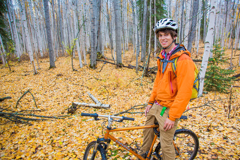 """Mechanical engineering major Adam McCombs rides his bike through the woods towards campus on a recent foggy morning.  <div class=""""ss-paypal-button"""">Filename: LIF-12-3556-131.jpg</div><div class=""""ss-paypal-button-end"""" style=""""""""></div>"""
