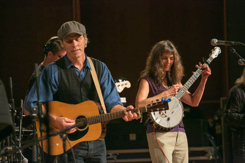 """The Fairbanks duo of Pat Fitzgerald, left, and Robin Dale Ford, center, performed along with backup musicians during one of two live recorded performances of the nationally broadcast radio show Mountain Stage in the Davis Concert Hall Aug. 17 and 18. The shows were sponsored by UAF Summer Sessions and KUAC-FM.  <div class=""""ss-paypal-button"""">Filename: LIF-12-3502-314.jpg</div><div class=""""ss-paypal-button-end"""" style=""""""""></div>"""