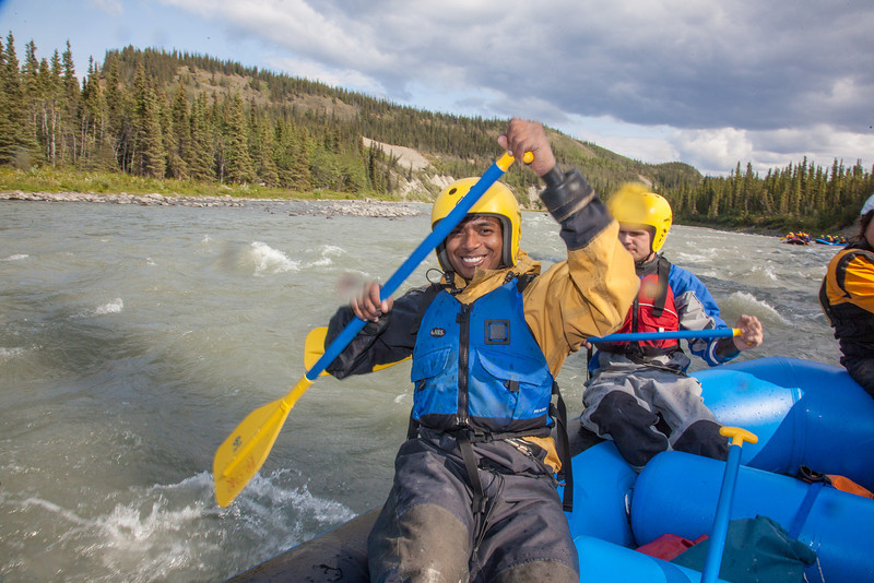 """Graduate student Vaibhav Raj paddles down the Nenana River during a day-long raft trip with UAF Outdoor Adventures.  <div class=""""ss-paypal-button"""">Filename: OUT-12-3492-106.jpg</div><div class=""""ss-paypal-button-end"""" style=""""""""></div>"""