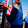 "Student veteran, MaCherie Dunbar, holds the Alaskan Flag during the opening ceremony of the 2013 Midnight Sun Intertribal Powwow.  <div class=""ss-paypal-button"">Filename: LIF-13-3881-8.jpg</div><div class=""ss-paypal-button-end"" style=""""></div>"