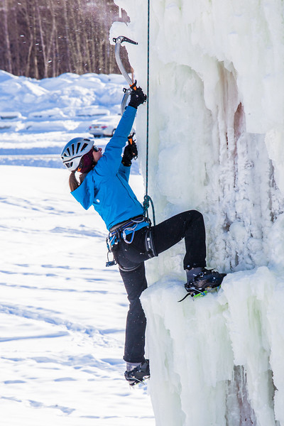 """Students take advantage of nice spring weather to try out their climbing skills on the new ice wall near the SRC.  <div class=""""ss-paypal-button"""">Filename: LIF-12-3321-091.jpg</div><div class=""""ss-paypal-button-end"""" style=""""""""></div>"""