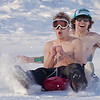 "Bryan Johnson, front, and his buddy Jimmy Donohue spend some quality time on the UAF sledding hill on a nice February afternoon.  <div class=""ss-paypal-button"">Filename: LIF-12-3290-65.jpg</div><div class=""ss-paypal-button-end"" style=""""></div>"
