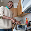 "Peter Ikewun, a petroleum engineeering graduate student from Nigeria, prepares a traditional African soup in his communal Wickersham Hall kitchen.  <div class=""ss-paypal-button"">Filename: LIF-12-3268-184.jpg</div><div class=""ss-paypal-button-end"" style=""""></div>"