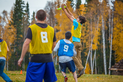 Mechanical engineering major Adam McCombs makes a leaping catch during a bout of utlimate frisbee in the field near the University of Alaska's Museum of the North on a fall afternoon.  Filename: LIF-12-3557-158.jpg