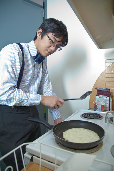 """Freshman petroleum engineering major Marx Smith makes breakfast in the Skarland Hall communal kitchen while the Commons was closed during Spring Break.  <div class=""""ss-paypal-button"""">Filename: LIF-12-3322-043.jpg</div><div class=""""ss-paypal-button-end"""" style=""""""""></div>"""