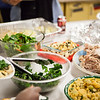 "The ceramic tables, which usually are a workstation for student potters working with clay is transformed to a table spread, filled with delicious food at the annual Thanksgiving gathering at the ceramics department.  <div class=""ss-paypal-button"">Filename: LIF-12-3660-59.jpg</div><div class=""ss-paypal-button-end"" style=""""></div>"