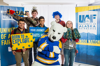 Future UAF students and family members pose with the Nanook mascot during Inside Out.  Filename: LIF-16-4839-35.jpg