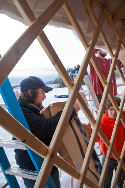 "Art major Bryson DeRonde, left, lends a helping hand during the installation of a yurt set up next to the outdoor climbing wall by the SRC. The structure will serve as a warm-up hut and to store safety gear.  <div class=""ss-paypal-button"">Filename: LIF-12-3287-16.jpg</div><div class=""ss-paypal-button-end"" style=""""></div>"