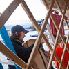 """Art major Bryson DeRonde, left, lends a helping hand during the installation of a yurt set up next to the outdoor climbing wall by the SRC. The structure will serve as a warm-up hut and to store safety gear.  <div class=""""ss-paypal-button"""">Filename: LIF-12-3287-16.jpg</div><div class=""""ss-paypal-button-end"""" style=""""""""></div>"""