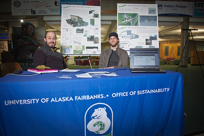 "Wyatt Hurlbut, left, and Brett Parks, board members for UAF's Office of Sustainability, solicit input into a proposed super energy efficient ""sustainable village""  under consideration for construction on the Fairbanks campus.  Filename: LIF-11-3214-05.jpg"