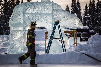Aaron Stevens fills an outdoor ice rink for children at Ice Alaska's George Horner Ice Park in Feb. 2013.  Filename: LIF-12-3723-180.jpg