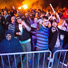 "Students and community members dance to the music while the bonfires rages on at Starvation Gulch Saturday, September 29, 2012 at the UAF Taku Parking lot.  <div class=""ss-paypal-button"">Filename: LIF-12-3573-55.jpg</div><div class=""ss-paypal-button-end"" style=""""></div>"