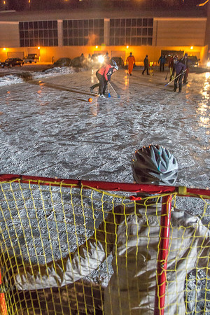 Outdoor broomball, played on the ice in front of the SRC, is a popular intramural sport at UAF.  Filename: LIF-12-3652-194.jpg