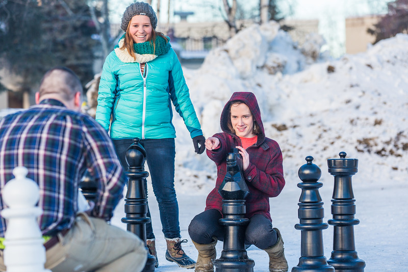 """From left: James Gilchrest, Johanna Bocklet, and Jessica Herzog play outdoor chess during winter on campus.  <div class=""""ss-paypal-button"""">Filename: LIF-16-4803-40.jpg</div><div class=""""ss-paypal-button-end""""></div>"""