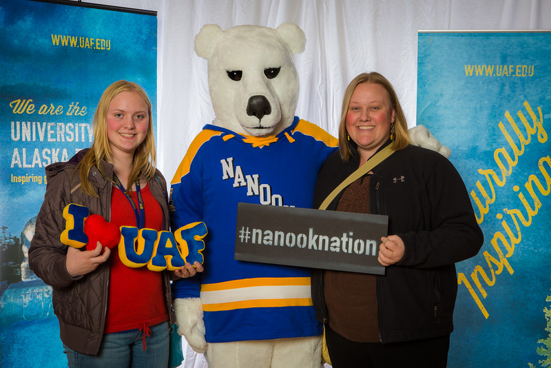 """Parents and prospective students pose with the UAF mascot during the Fall 2015 Inside Out event hosted by UAF's office of admissions and the registrar.  <div class=""""ss-paypal-button"""">Filename: LIF-14-4353-44.jpg</div><div class=""""ss-paypal-button-end""""></div>"""