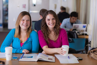 UAF students Megan Gilmore and Ashley Bartolowits sit with their cofee and study materials in the 24-hour study area of the Rasmuson Library.  Filename: LIF-11-3212-147.jpg